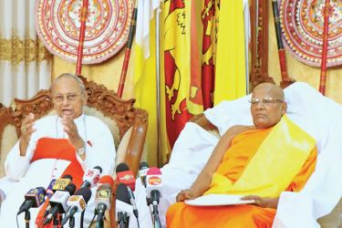Archbishop of Colombo His Eminence Malcolm Cardinal Ranjith and the Chancellor of the University of Sri Jayawardanepura Dr. Ittapana Dhammalankara Maha Nayake Thera speaking during a joint media briefing convened  at Bishop's House in Colombo yesterday. Picture by Saman Sri Wedage