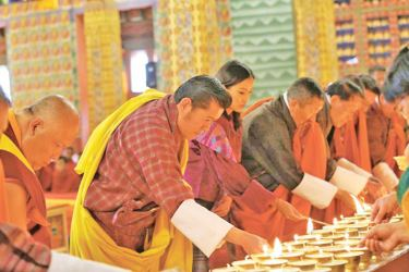 King Jigme Khesar Namgyel Wangchuck lighting butter lamps in commemoration of the victims of the Easter Sunday bomb attack in Sri Lanka.
