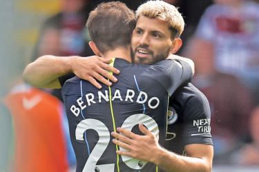Back on top: Sergio Aguero (right) scored the only goal in Manchester City's 1-0 win at Burnley.  AFP