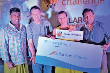 First Place winners team TEAM MACAW -  Tilde Andrea Seider and Rasmus Bo Rasmussen from Denmark posing for the photograph with Anushka Perera, General Manager, Connaissance de Ceylan (extreme left) and D.P. Daluwatte, Director Events, Sri Lanka Tourist Promotion Bureau (extreme right) after receiving the Sri Lanka Airlines sponsorship cheque. PICTURES BY HERBERT PERERA
