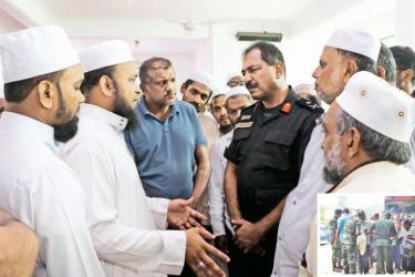 OOC Commander Major General Sathyapriya Liyanage speaks with Islamic religious leaders in Ampara on Tuesday. Inset: Troops stepped up security in the Eastern Province, as it returned to normalcy.