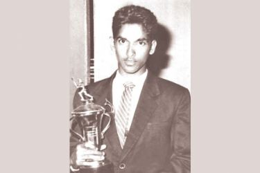 Pictured 1997: Chinthaka Jayasinghe of Dharmapala Vidyalaya, Pannipitiya displays his trophy.