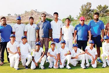 The touring H. G. Academy of Padukka, Sri Lanka played their first game of the Yisa Cup against Cosmic Cricket Academy, Bangalore, India at Kini Sports Arena Grounds. H. G. Academy Cricket Team posed for a photograph prior to the commencement of the match with the officials of the team. (Picture by Moratuwa Sports Special Correspondent)