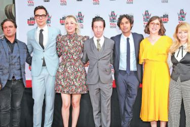 """Johnny Galecki, Jim Parsons, Kaley Cuoco, Simon Helberg, Kunal Nayyar, Mayim Bialik and Melissa Rauch from the cast of """"The Big Bang Theory"""" attend their handprint ceremony at the TCL Chinese Theatre IMAX on  in Hollywood, California."""