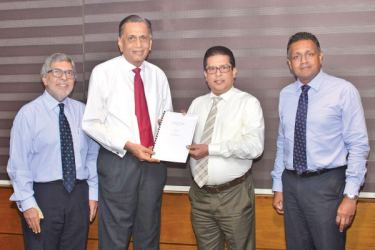 Fayaz Saleem - President Emeritus, The Management Club, Sega Nagendra – Founder member of The Management Club, Lakshman Silva – CEO, DFCC Bank and Thimal Perera – DCEO, DFCC Bank, exchanging the agreement