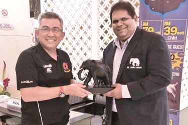 Sri Lanka Rugby president Lasitha Gunaratne handing over a memento to his Malaysian counterpart 'Dato' Shahrul Zaman Bin Yahya soon after the match to mark the first unofficial match between the two countries.