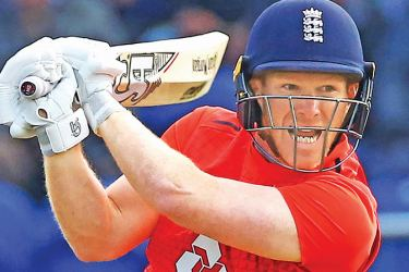 England's Eoin Morgan cuts for runs during the international Twenty20 cricket match against Pakistan at Sophia Gardens in Cardiff on Sunday. – AFP
