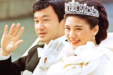 Crown Prince Naruhito of Japan and Masako Owada waving to the crowds after their marriage  in 1993