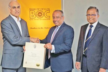 "Brand Finance Lanka Managing Director Ruchi Gunawardene, hands over the ""Most Valuable Banking Brand"" certificate to the Bank's Chairman, President's Counsel Ronald C. Perera. The Bank's CEO/ General Manager Senarath Bandara is also in picture."