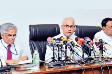 Minister, John Amaratunge, State Minister Eran Wickramaratne and Finance Ministry Secretary, Dr. R. H. S. Samaratunge at the event. Picture by Gayan Pushpika