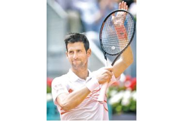 Serbia's Novak Djokovic celebrates after defeating US Taylor Fritz during their ATP Madrid Open round of 64 tennis match at the Caja Magica in Madrid on May 7. AFP