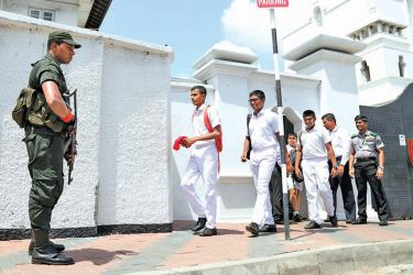 Students leave Ananda College, Colombo, at the close of the school day on Monday.  Picture by Wasitha Patabendige