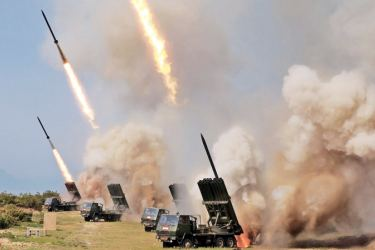 This picture taken on May 4, 2019 and released from North Korea's official Korean Central News Agency (KCNA) shows rocket launchers firing during a test of weapons in an undisclosed location in North Korea.