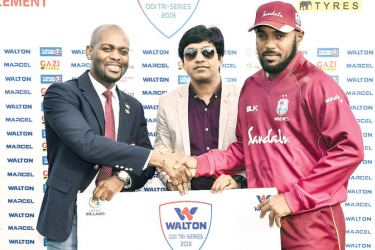 West Indies batsman Sunil Ambris receives the Man of the Match award for his match winning hundred against Ireland in the tri-series match played at Dublin on Saturday.