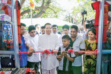 President Maithripala Sirisena inaugurating one of the shops at the new market complex in Polonnaruwa.