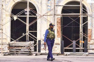 A soldier stands guard outside St. Anthony's Shrine on May 5, two weeks after a series of bomb blasts targeting churches and luxury hotels. - AFP