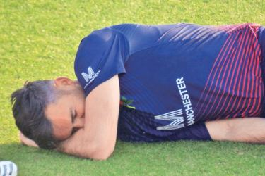 James Anderson falls to ground after being struck on the leg in the One-Day Cup semi-final between Lancashire and Hampshire at Southampton.