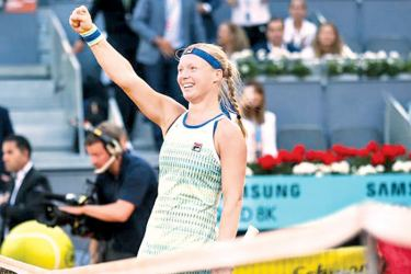 Kiki Bertens celebrates her flawless win over Simona Halep in the Madrid Open final on Saturday.
