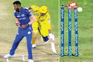 Two angles of MS Dhoni's run out dismissal