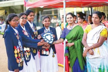 Azisa Sheriffdeen, (Yasodara) Hashini Prabodhima(Gothamie), Ranmini Suriyabandara (Sangamitta) and Sandani Ratnayake(Chitra) House Captains  receiving a Joint Trophy from Chulanie Ekanayake, the Guest of honour
