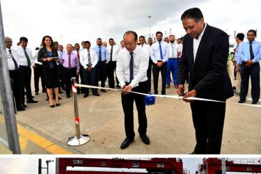 Sri Lanka Ports Authority Chairman Kavan Rathnayake (above, right) and CICT CEO Jack Huang ceremonially open CICT's Dangerous Goods Storage Facility (below).