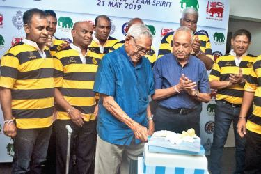 The Royal College rugby team of 1982 celebrate the spirit of Bradby and birthday of Summa Navaratnam who cuts the cake with Malik Samarawickrama, Minister of Development Strategies and International Trade, in attendance at the CR and FC on Tuesday. Picture by Siripala Halwala