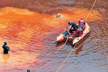 Cyprus forensic Police officers probe the Red Lake out of the village of Mitsero, southwest of the capital Nicosia.