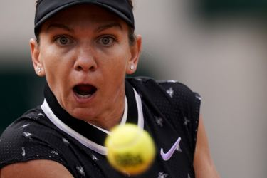 Romania's Simona Halep eyes the ball as she plays against Poland's Magda Linette during their women's singles second round match on day five of The Roland Garros 2019 French Open tennis tournament in Paris on Thursday. – AFP