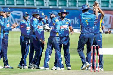 The Sri Lanka team rejoice during a warm-up match.