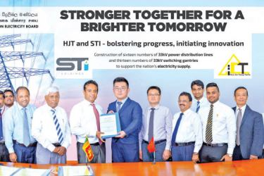 CEB Vice Chairman R. Selvaraj and President of  HJT - China, Liu Kai pictured with the signed contract along with Collin Fernando, Chairman STI; R. Wickramarachchi, CEB Board Director; and Zhu Guiying, CFO HJT. Also pictured are directors from STI Holdings.