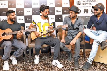 Sanam, one of the five international music groups which has put together the anthem, play for a radio audience in Mumbai, India. From Left, Venky S, Samar Puri, Sanam Puri, and Keshav Dhanraj