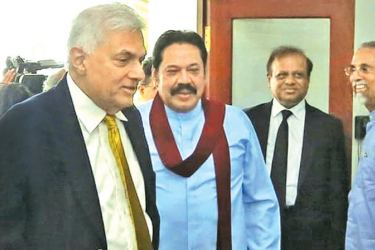 Prime Minister Ranil Wickremesinghe receiving Opposition Leader Mahinda Rajapaksa at Temple Trees yesterday.
