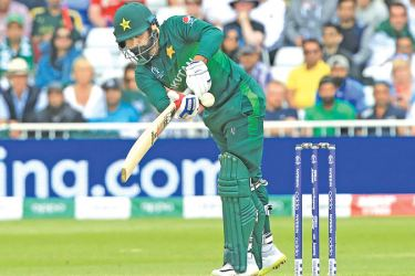 Mohammad Hafeez plays a shot during the 2019 Cricket World Cup group stage match between England and Pakistan at Trent Bridge in Nottingham, central England, on June 3. AFP