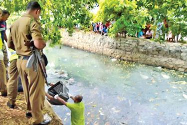 Police retrieve the foetus from the canal.
