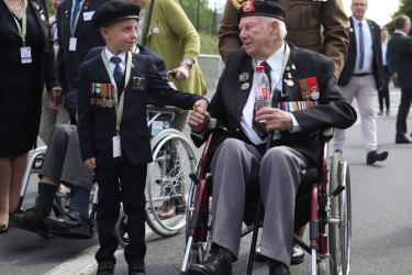 Six-year-old George Sayer meets 95-year-old D-Day veteran John Quinn. World leaders met in northern France to mark the 75th anniversary of the Normandy invasion.
