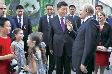 Chinese President Xi Jinping and Russian President Vladimir Putin attend an opening ceremony of a giant panda house in the Moscow Zoo on Wednesday.