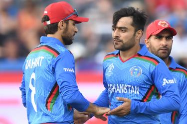 Afghanistan's Rashid Khan (R) celebrates with teammates after dismissing lbw Australia's Usman Khawaja  during the 2019 Cricket World Cup group stage match between Afghanistan and Australia at Bristol County Ground in Bristol, southwest England, on June 1. - AFP