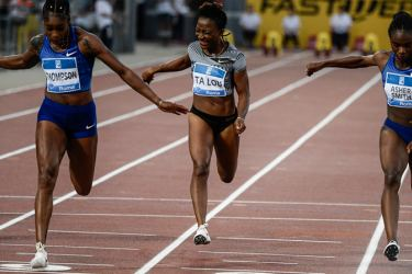Jamaica's Elaine Thompson (L) wins the Women's 100m ahead of Britain's Dina Asher-Smith (R) and Ivory Coast Marie-Josee Ta Lou (4th place) during the IAAF Diamond League competition on Thursday at the Olympic stadium in Rome. - AFP
