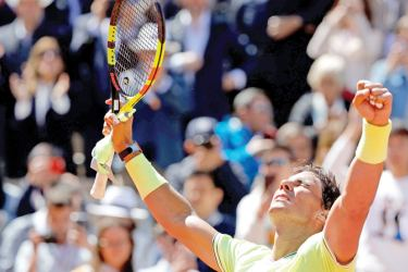 Spain's Rafael Nadal celebrates after winning against Switzerland's Roger Federer during their men's singles semi-final match on day 13 of The Roland Garros 2019 French Open tennis tournament in Paris on June 7, 2019. (AFP)