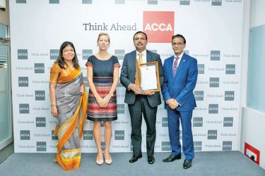 Mahesh Jayasuriya Assistant General Manager Logistics and Procurement receives the Award.