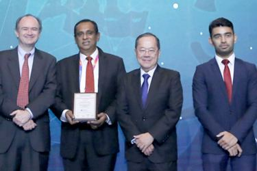 Commercial Bank's Deputy General Manager - Corporate Banking  Naveen Sooriyarachchi (2nd from left) accepts the award won by the Bank at the 2019 Asian Banker Transaction Awards ceremony in Bangkok