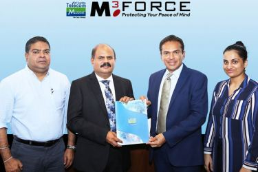 Exchanging of the strategic partnership agreement between (middle) Sri Lanka Telecom and Mobitel Chairman, P. G. Kumarasinghe Sirisena and Chairman - WatchGuard Security and Investigations Pvt Ltd/M3force Pvt Ltd Major Vijith Welikala. Also present were (from left) Mobitel Chief Executive Officer, Nalin Perera and Director - WatchGuard Security and Investigations Pvt Ltd/M3force Pvt ltd, Jithmi Welikala.