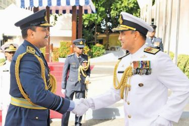 Navy Commander Vice Admiral Piyal De Silva greets Air Force Commander Air Marshal Sumangala Dias when the Air Force chief visited the Naval Headquarters yesterday.