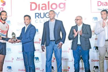 The highest try scorerer at the Dialog Rugby Club 7s, Kavindu Perera of Kandy SC, receives the trophy from Thisara Kasthuriarachchi, General Manager - Mobile Broadband and Pre-Paid Mobile, Dialog Axiata PLC. Also in picture (L-R), Nazeem Mohamed – Vice President, Thusitha Peiris – Honorary Secretary, Sri Lanka Rugby and Harsha Samaranayake – Senior General Manager – Brand & Media - Dialog Axiata PLC, Sri Lanka Rugby.