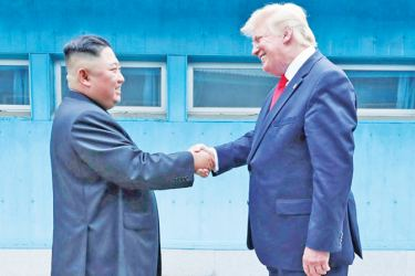 Kim and Trump shook hands over the concrete blocks dividing North and South before Trump became the first US President ever to set foot on North Korean soil.