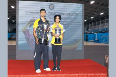 National table tennis champions Chameera Ginige and Bimandee Bandara with their trophies.