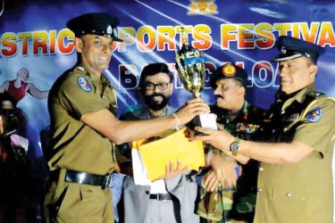 Champion trophy for the Police Department handed over by the ASP Batticaloa R. Kumarasiri.