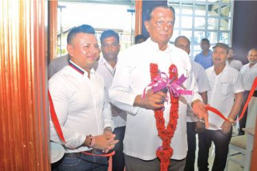 Minister John Amaratunga and Chairman Curry Pot Restaurant, Shyamal Wickramasingha at the opening. Picture by Sudath Malaweera