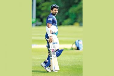 Kusal Perera  prepares to have a  batting session.