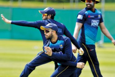 The Sri Lanka team at practice preparing for their final World Cup match against India at Leeds.